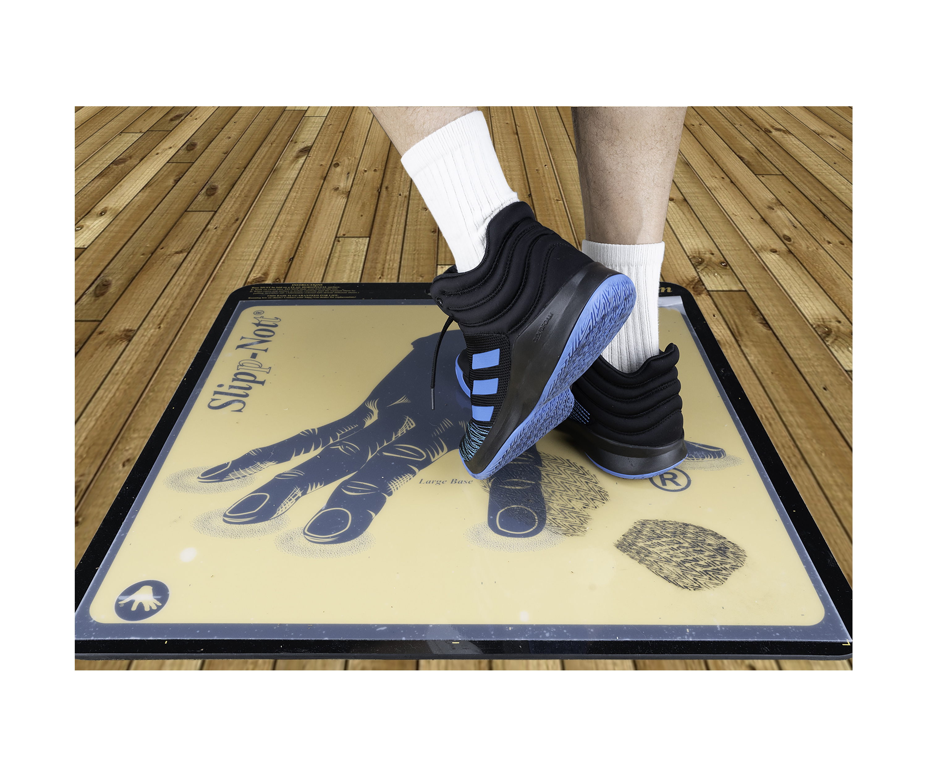 Athlete steps on adhesive sports traction mat to lift dirt from sneaker soles