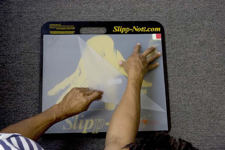 Step 6 of Slipp-Nott Traction Mat Mounting