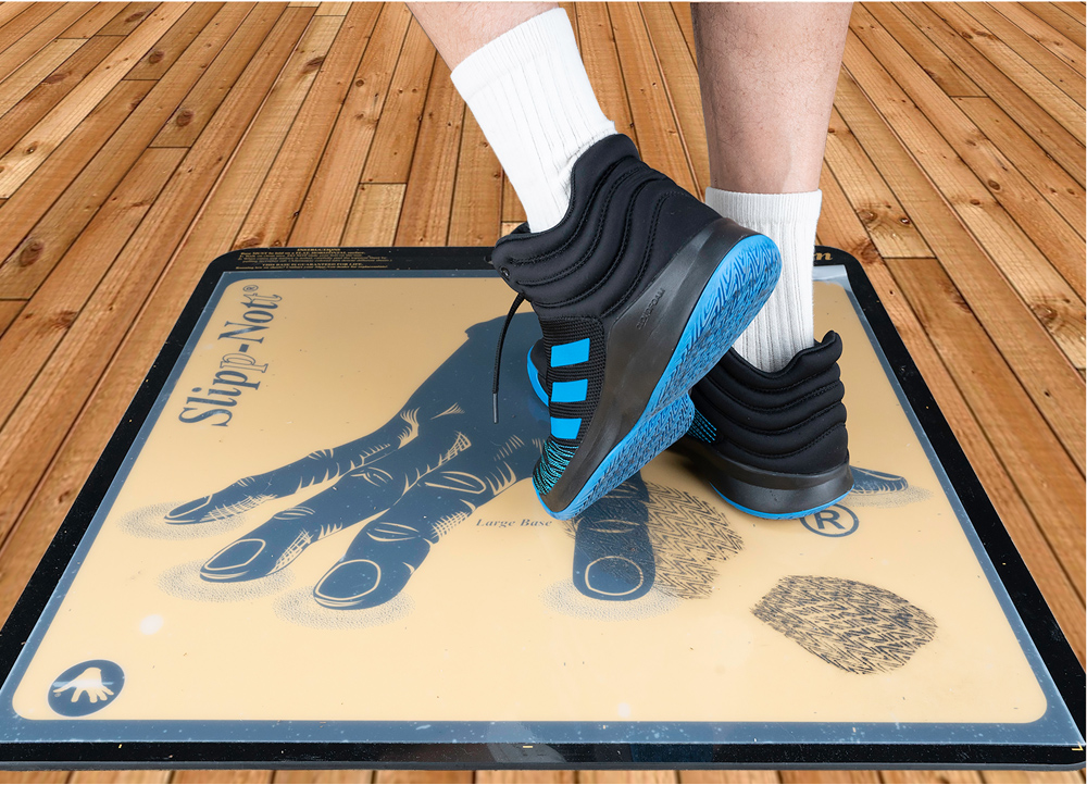 cleaning basketball shoes on Slipp-Nott traction mat