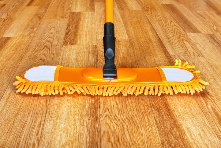 Broom on hardwood court floor